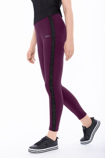 Stretch leggings with lateral lurex bands