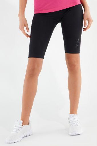 Plain colour cycling shorts with a shiny print