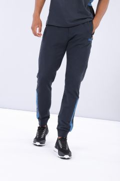 Blue tapered leg athletic trousers with mesh inserts and a No-Logo logo