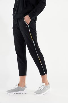 Tapered trousers with tropical print lateral trim