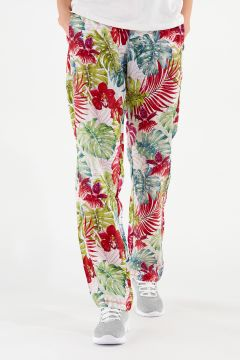 Relaxed fit tropical flower print trousers in plant-based fabric