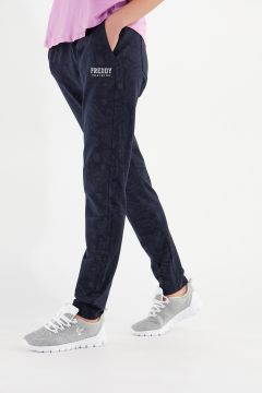 Tapered athletic trousers with a paisley print