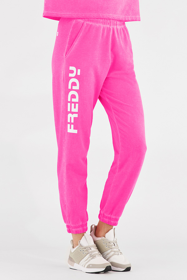 Neon athletic pants with white Freddy logo